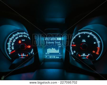 Close Up Shot Of A Speedometer And Interior Modern Car Console With Economy Trend Value.