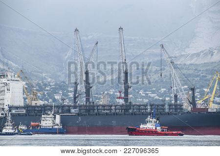 Novorossiysk, Russia - May 28, 2016: The International Sea Port Of Novorossiysk. Port Cranes And Ind