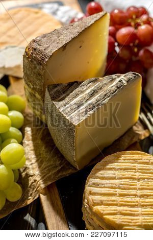 Tasting Of Oldest French Aoc Soft Pudgent Yellow Cheese Livarot, Munster And Semifirm Tomme, Made Fr