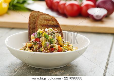 Vegan Quinoa Salad With Chick Peas, Veggies And Fresh Bread