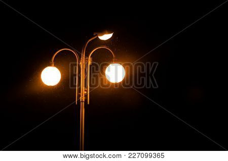 A Lighted Lantern On A Pole, In The Dark, For Any Purpose