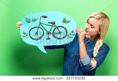 Eco Bicycle With Young Woman Holding A Speech Bubble