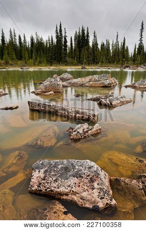 Large Rocks In A Pond In The Forest, Jasper National Park, Alberta, Canada