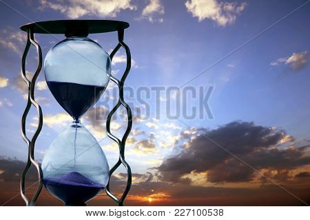 The A Hourglass On The Background Of Sunset