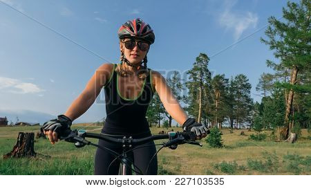 Fat Bike Also Called Fatbike Or Fat-tire Bike In Summer Riding In The Forest. Beautiful Girl And Her