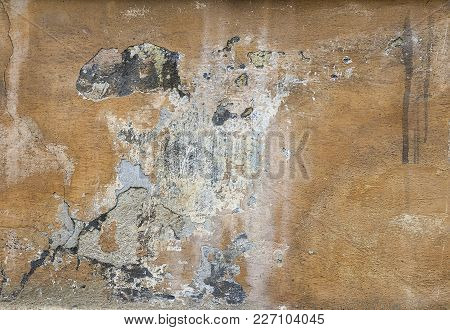 Old Wall With Cracked And Peeling Stucco. Texture Background.