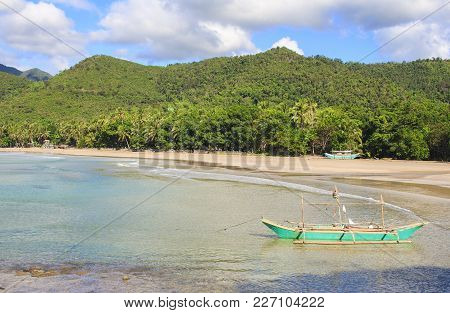 Landscape Of The Beach Of Nagtabon. The Island Of Palawan. Philippines.