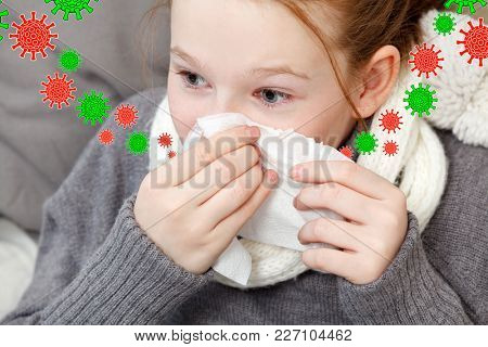 Portrait of child blowing nose in bed, illness concept. Sick kid girl. Flu virus season.  Nose cold.
