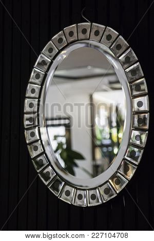 Retro Styled Oval Mirror With Room Reflection, Stock Photo