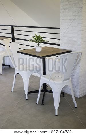 White Steel Chair And Wooden Table, Stock Photo