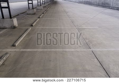 Concrete Lot Of Outdoor Empty Parking With Steel Tube Structure Or Roof