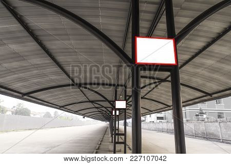 Blank Board Sign On Steel Pole Of Parking Garage In Shopping Mall