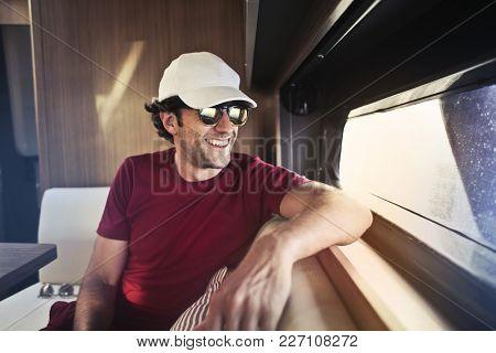 Smiling man wearing a white hat