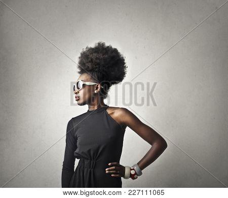 Stylish woman wearing white sunglasses