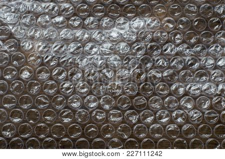 Air bubble, protective foil on a wooden surface. Close-up