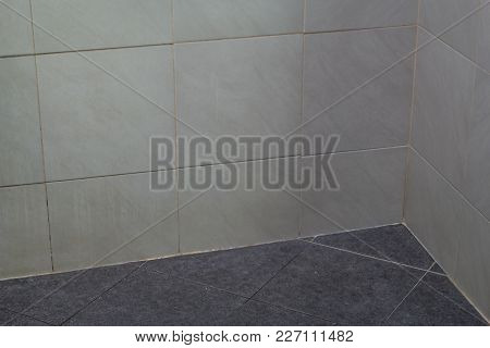 White Wall And Black Floor With Tiled In Bathroom