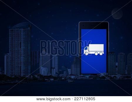 Truck Flat Icon On Modern Smart Phone Screen With Office City Tower, River And Fantasy Night Sky, Bu