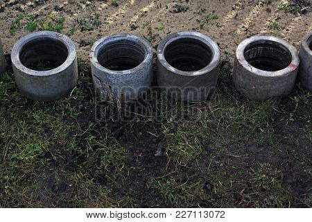 Four Concrete Drainage Pipes Are Folded In A Row