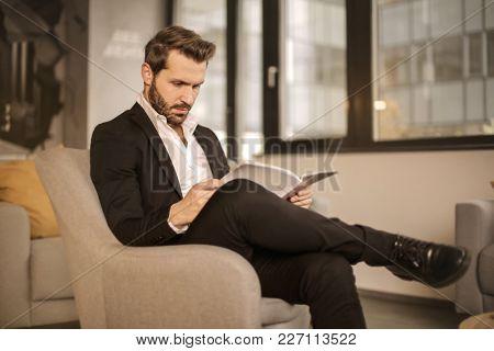 Elegant man reading