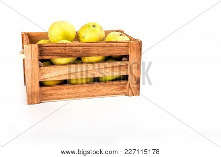 Green Apples In A Box On A White Background