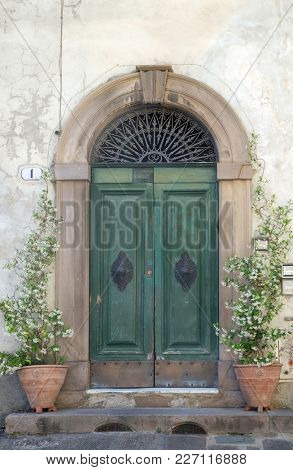 LUCCA, ITALY - JUNE 03: Residential doorway detail from the medieval town Lucca, Tuscany, Italy on June 03, 2017.