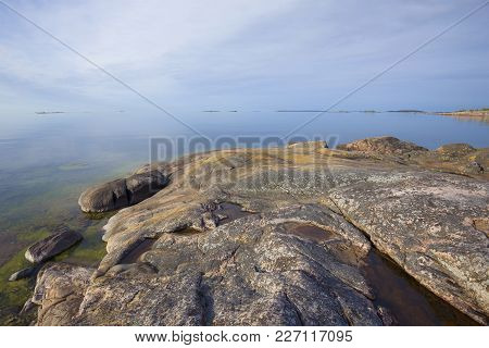 A Serene June Morning On The Rocks Of The Peninsula Of Hanko. Finland