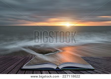 Creative Book Image Of Beautiful Vibrant Sunset Landscape Image Of Burton Bradstock Golden Cliffs In