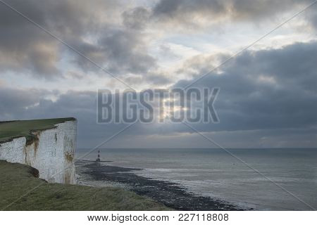 Stunning Landscape Image Of Beachy Headt Lighthouse On South Downs National Park During Stormy Sky