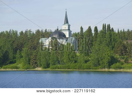 Old Lutheran Church On The Church Hill In The Sunny June Afternoon. Ruokolakhti, Finland