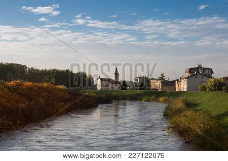Little Brook , Church And Houses In Colorno, Parma, Emilia Romagna Region, Italy-