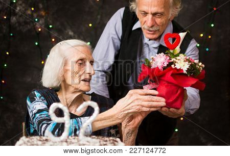 Senior Woman Receiving A  Present On Birthday Celebration
