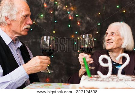 Senior People Toasting With Alcohol On A Birthday Celebration