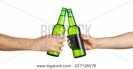 Male Hands With Cold Beer Green Bottles, Isolated On White Background. Beer Up. Cheers. Pair Of Beer