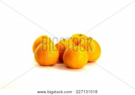 Tangerines, Citrus Several Pieces Lie In Different Order On White Background