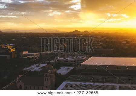 Panoramic View Of Phoenix, Arizona, Skyline At Sunrise. Camelback Mountain In The Distance.
