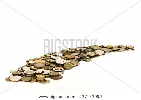 Money Coins Lie On White Background Going Into The Distance