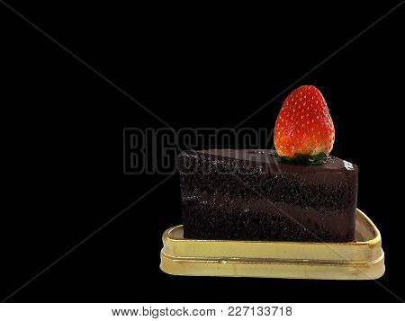 Chocolate Cake And Strawberry Placed On Golden Tray On Black Background