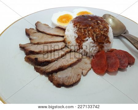Rice With Roasted Red Pork And Boiled Egg And Chinese Sausage Served With Stewed Gravy Sauce