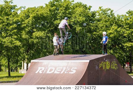St. Petersburg, Russia - 15 June, A High Jump On The Bike, 15 June, 2017. Teenagers On Bicycles In T