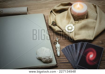 Tarot Cards Deck And Open Book Of Magic With Copy Space On Fortune Teller Desk Table Bakground. Futu