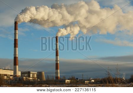 Energy. Smoke From Chimney Of Power Plant Or Station. Industrial Landscape At Day
