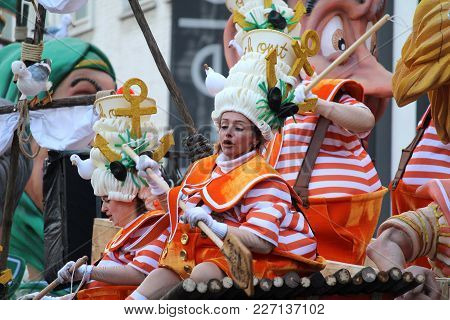 Aalst, Belgium, February 11 2018: Unknown Aalst Carnival Participant Enjoys The Annual Parade. The C