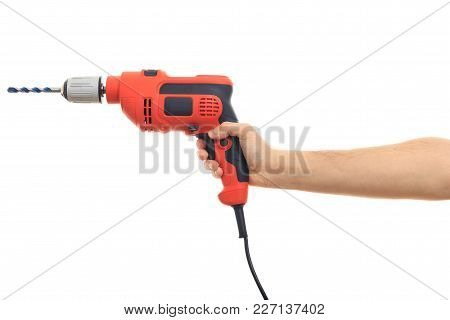 Hand Holding An Electric Drill On White Background