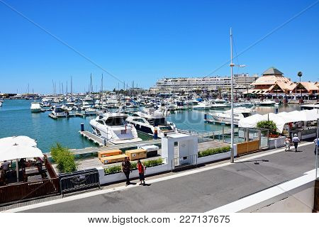 Vilamoura, Portugal - June 6, 2017 - Elevated View Of Yachts In The Marina With Waterfront Buildings
