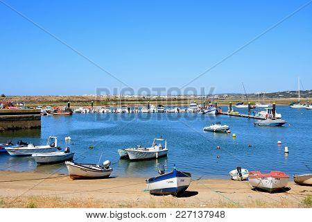 Alvor, Portugal - June 7, 2017 - Fishing Boats Moored On The Beach And In The Estuary, Alvor, Algarv