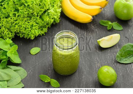Green Homemade Smoothies On Black Background. Selective Focus. Healthy Food, Diet, Detox, Clean Eati