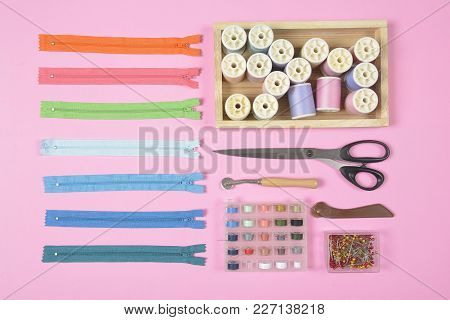 Flat Lay Of Sewing Material Contains The Scissors, Measuring Tape, Zipper, Pin And Colorful Thread R