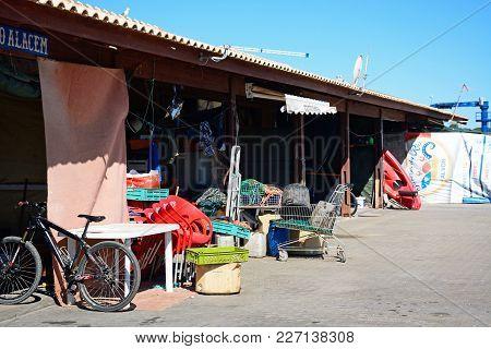 Alvor, Portugal - June 7, 2017 - Fishermens Storage Buildings Along The Waterfront, Alvor, Algarve,