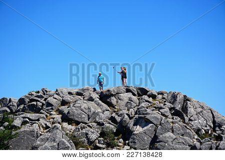 Foia, Portugal - June 7, 2017 - Tourists On A Mountain Peak Taking A Selfie In The Monchique Mountai
