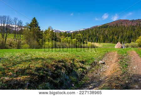 Country Road Through Rural Fields In Springtime. Lovely Nature Scenery At The Foot Of The Mountain W